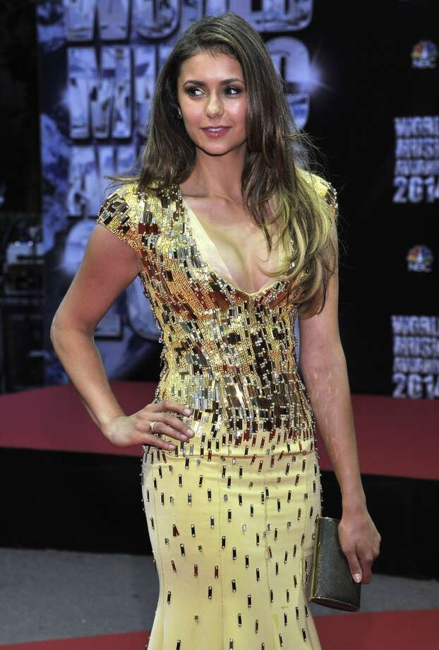 Bulgarian canadian actress Nina Dobrev poses as she arrives for the World Music Awards in Monaco, Tuesday, May 27, 2014. Photo: Bruno Bebert, Associated Press