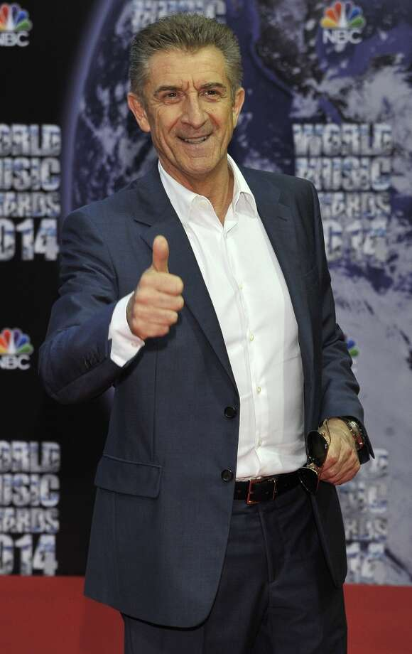 Italian actor Ezio Greggio poses as he arrives for the World Music Awards in Monaco, Tuesday, May 27, 2014. Photo: Bruno Bebert, Associated Press