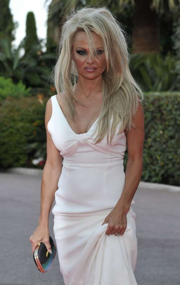 Canadian-American actress Pamela Anderson poses as she arrives for the World Music Awards in Monaco, Tuesday, May 27, 2014. Photo: Bruno Bebert, Associated Press