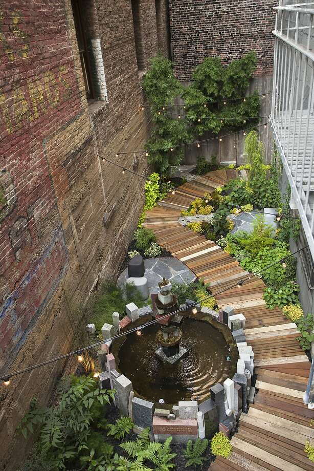 The Hummingbird Garden, designed and built by Organic Mechanics, is nestled between two old high-story brick buildings, behind the Mark Twain Hotel in San Francisco. Photo: Saxon Holt
