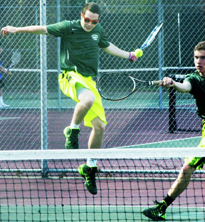 The athletic and, at times, dynamic Green Wave doubles tandem of twins Nick, left, and Scott Eherts has been prepping throughout the regular season for possible runs at South-West Conference and state tournament laurels for New Milford High School boys' tennis. May 2014 Photo: Norm Cummings / The News-Times