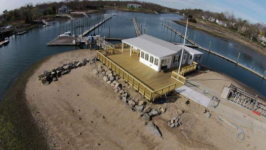 The new deck and three-season room at the Darien Boat Club was built to withstand massive storms, like Superstorm Sandy that ripped the old deck away from the building. Photo: Contributed Photo, Contributed / Darien News Contributed