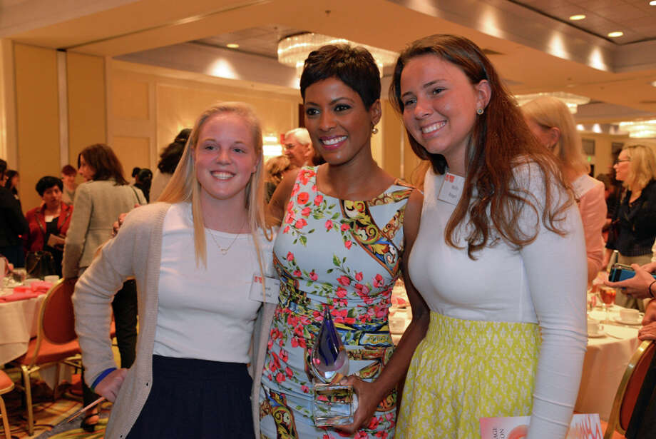 Darien High School students Sara Swirbul and Molly Riegel, the co-chairmn of the Domestic Violence Crisis Center's Teen PeaceWorks, meet with newswoman Tamron Hall, who was the guest speakr at the annual luncheon. Photo: Contributed Photo, Contributed / Darien News
