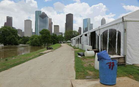 High water in Buffalo Bayou as workers prepare for the upcoming Free Press Summer Festival near Eleanor Tinsley Park along the banks of Buffalo Bayou Wednesday, May 28, 2014, in Houston. Photo: James Nielsen, Houston Chronicle / © 2014  Houston Chronicle