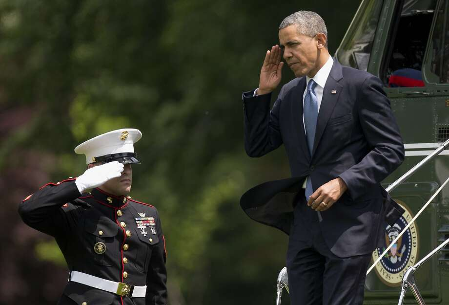 President Obama steps off Marine One at the White House, returning from delivering the commencement address at the U.S. Military Academy. Photo: Carolyn Kaster, Associated Press