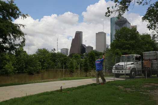 Recent flooding rains hit Houston and area bayou banks are overflowing with water. Eleanor Tinsley Park, located near a section of Buffalo Bayou -- the grounds surrounding the area probably soaked with water. Free Press Summer Fest is scheduled this weekend and workers are rearranging staging for safety of concert goers. Please get photos of stage crews assembling equipment Wednesday, May 28, 2014, in Houston. Photo: James Nielsen, James Nielsen / Houston Chronicle / © 2014  Houston Chronicle