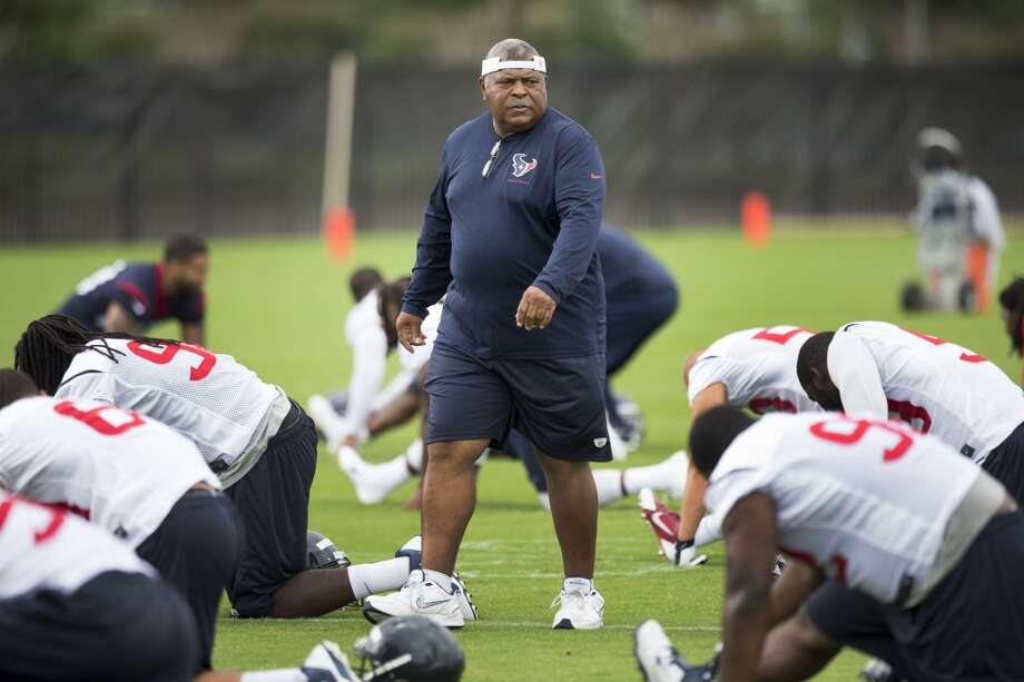 Texans defensive coordinator Romeo Crennell walks across the practice field. Photo: Brett Coomer, Houston Chronicle