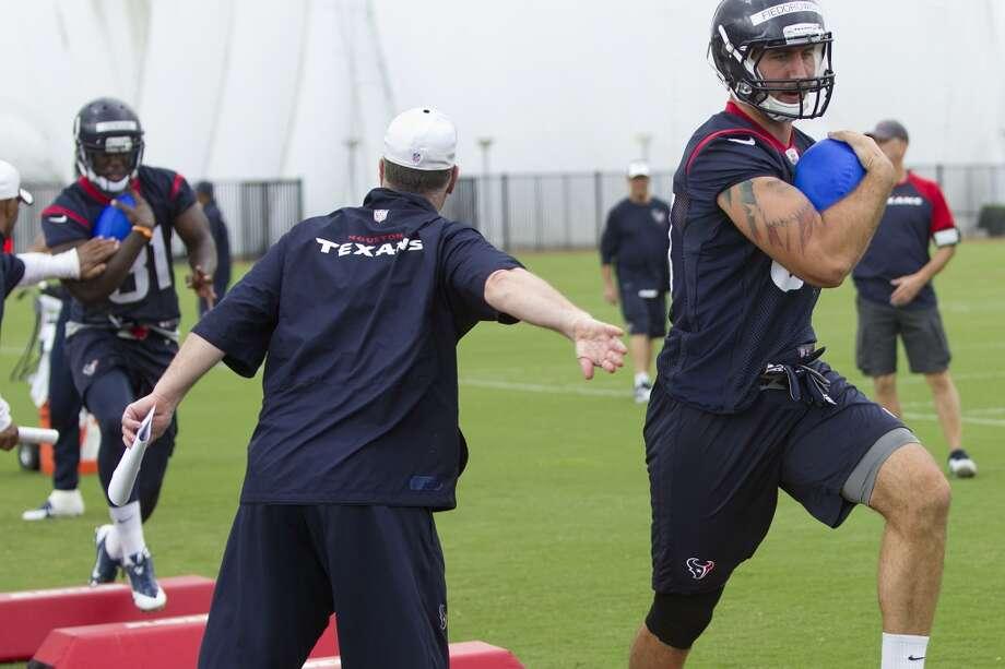 Texans tight end C.J. Fiedorowicz, right, runs through a drill. Photo: Brett Coomer, Houston Chronicle