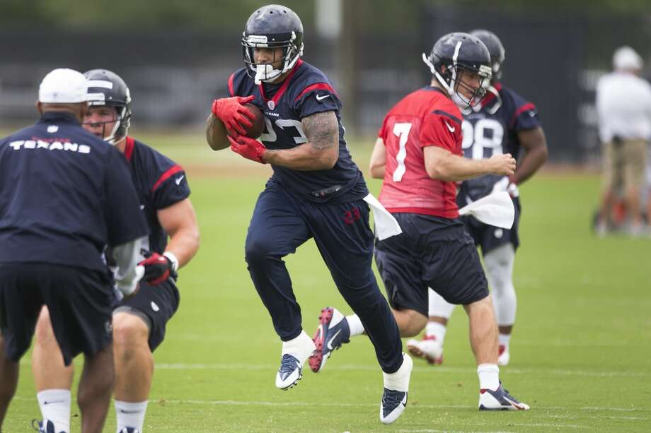 Texans running back Arian Foster (23) takes a handoff from quarterback Case Keenum (7). Photo: Brett Coomer, Houston Chronicle
