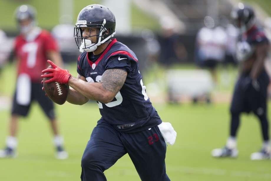 Texans running back Arian Foster (23) catches a pass from quarterback Case Keenum (7). Photo: Brett Coomer, Houston Chronicle