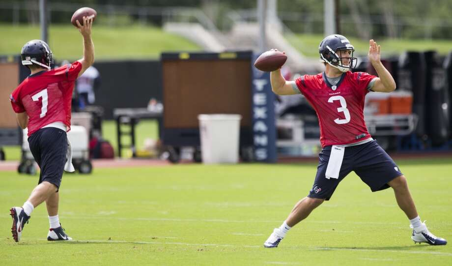 Texans quarterbacks Case Keenum (7) and Tom Savage (3) throw passes. Photo: Brett Coomer, Houston Chronicle