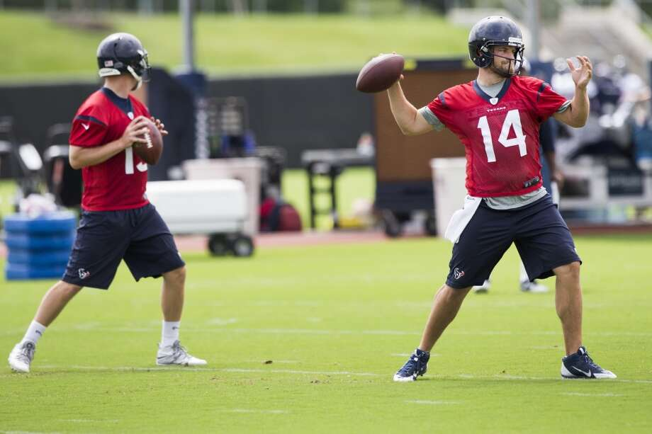Texans quarterbacks T.J. Yates (13) and Ryan Fitzpatrick (14) throw passes. Photo: Brett Coomer, Houston Chronicle