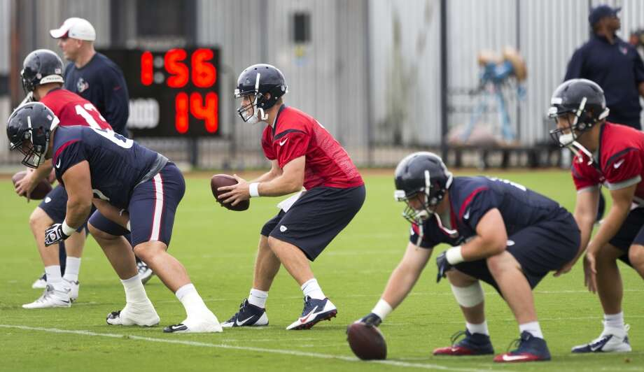 Texans quarterbacks take snaps from center. Photo: Brett Coomer, Houston Chronicle