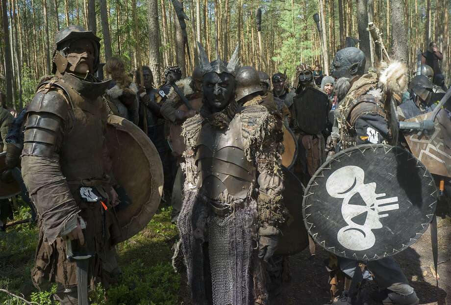 """What? So I like Mickey Mouse. Big deal:""""Orcs"""" assemble in forest near the village of Doksy, Czech Republic, during a re-creation of a battle from J.R.R. Tolkien's novel """"The Hobbit."""" Photo: Michal Cizek, AFP/Getty Images"""