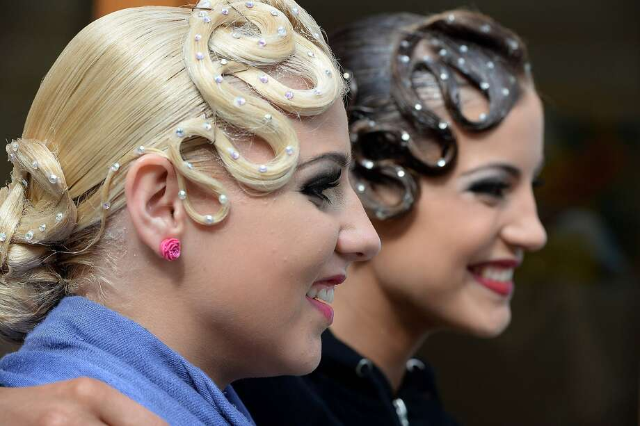 Guess who has the same hairdresser:Competitive ballroom dancers wait their turns at the British Open Dance Championships in Blackpool, England. Photo: Nigel Roddis, Getty Images