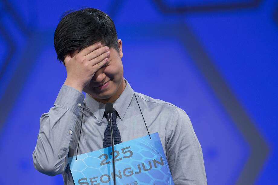 "There's a 't' in it?! Seongjun Lee of Seoul stumbles on the word ""apparatchik"" during the preliminary round of the National Spelling Bee in Oxon Hill, Md. Photo: Evan Vucci, Associated Press"