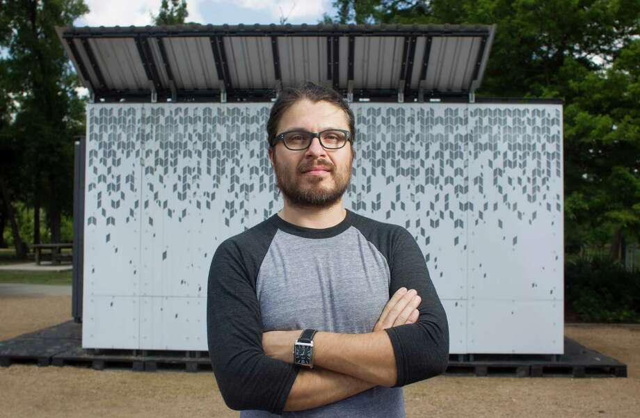 "Abinadi Meza, shown in front of his art installation ""Vein of Sky,"" teaches a graduate art program at UH. Photo: Johnny Hanson / © 2014  Houston Chronicle"