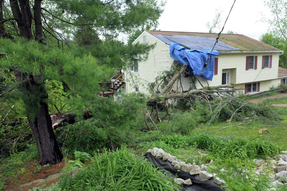 This house on Russeling Ridge Road in New Milford, Conn. was damaged by a falling tree after a rain storm Tuesday night, May 28, 2014. Photo: Carol Kaliff / The News-Times
