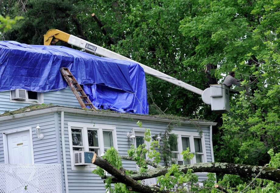 Trees are down in areas of New Milford, Conn. Wednesday, May 28, 2014, the result of a rain storm Tuesday night. Photo: Carol Kaliff / The News-Times
