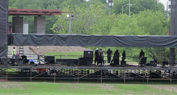 Workers prepare the stage for the upcoming Free Press Summer Festival near Eleanor Tinsley Park along the banks of Buffalo Bayou Wednesday, May 28, 2014, in Houston. Photo: James Nielsen, Houston Chronicle / © 2014  Houston Chronicle