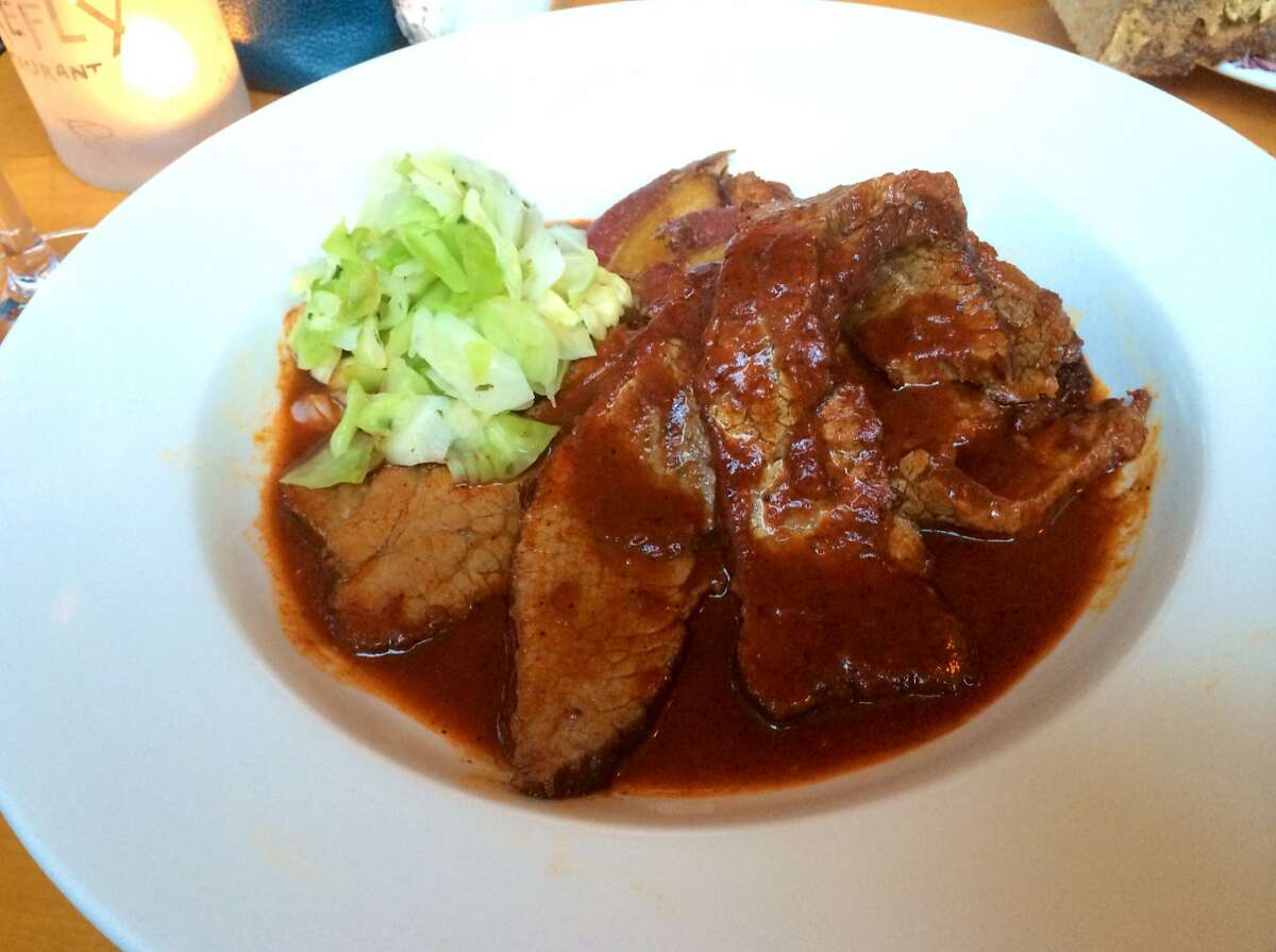 Chile-braised beef brisket with sweet potato tostones and lime-marinated cabbage salad.