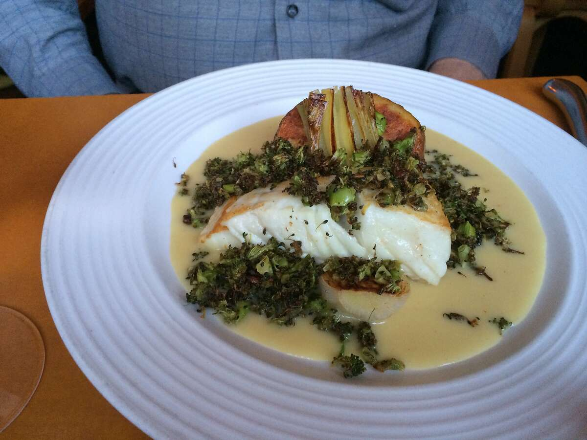 Seared halibut with roasted broccoli and anchovy gremolata with braised leeks, new-crop potatoes, and a fennel and potato sauce,