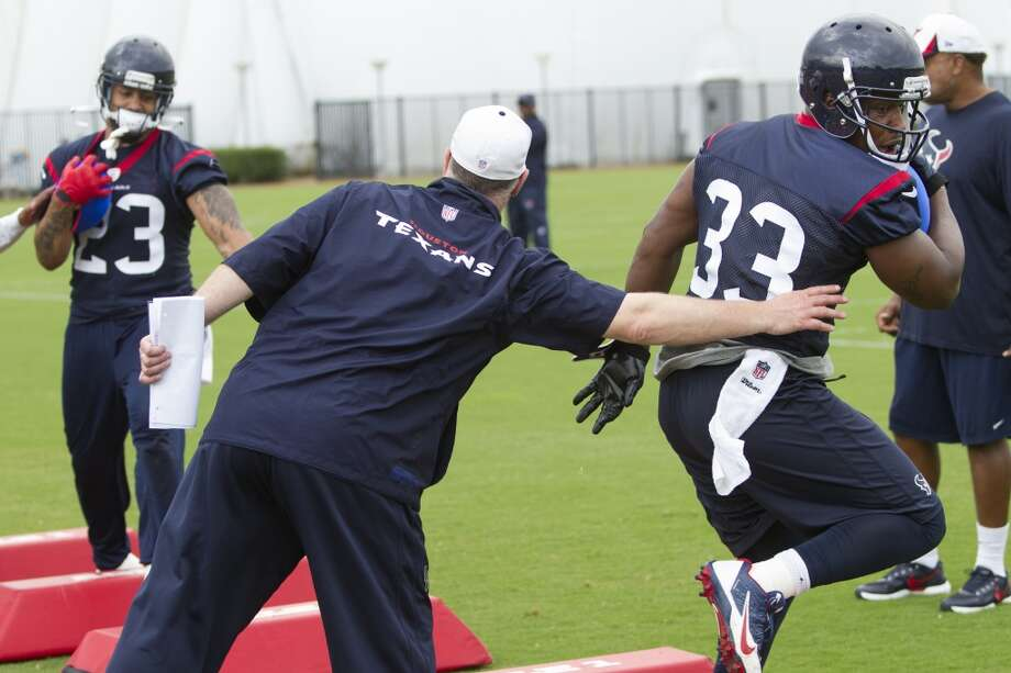 Texans running backs Arian Foster (23) and Andre Brown (33) run through drills. Photo: Brett Coomer, Houston Chronicle