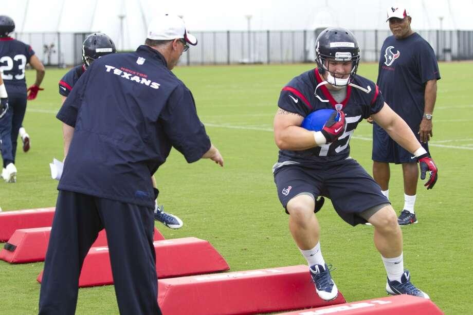 Texans fullback Jay Prosch (45) runs a drill. Photo: Brett Coomer, Houston Chronicle