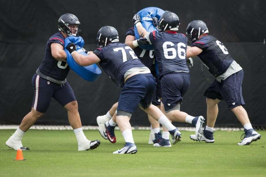 Texans offensive linemen run through blocking drills. Photo: Brett Coomer, Houston Chronicle
