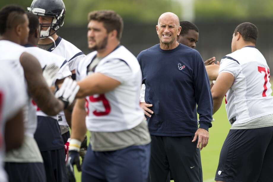 Texans defensive line coach Bill Kollar watches his players warm up. Photo: Brett Coomer, Houston Chronicle