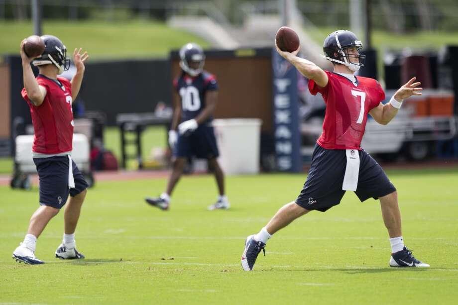 Texans quarterbacks Tom Savage (3) and Case Keenum (7) throw passes. Photo: Brett Coomer, Houston Chronicle