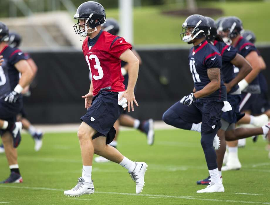 Texans quarterback T.J. Yates (13) runs warm up drills. Photo: Brett Coomer, Houston Chronicle
