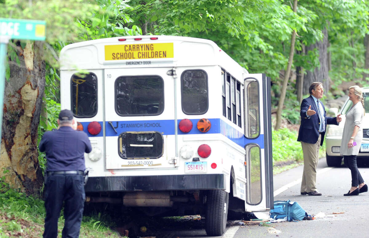 The Head of Stanwich School, Paul Geise, second from right, at the scene of an accident involving a Stanwich School bus on Stanwich Road in Greenwich, Wednesday afternoon, May 28, 2014.