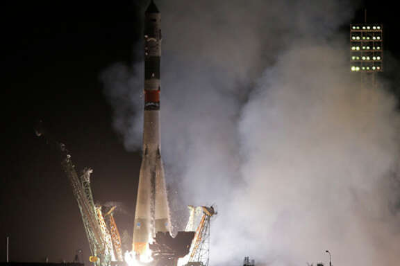 The Soyuz-FG rocket booster with Soyuz TMA-13M space ship carrying a new crew to the International Space Station, ISS, blasts off at the Russian leased Baikonur cosmodrome, Kazakhstan, Thursday, May 29, 2014. The Russian rocket carries European Space Agency's astronaut Alexander Gerst, Russian cosmonaut Maxim Suraev, and NASA astronaut Reid Wiseman.