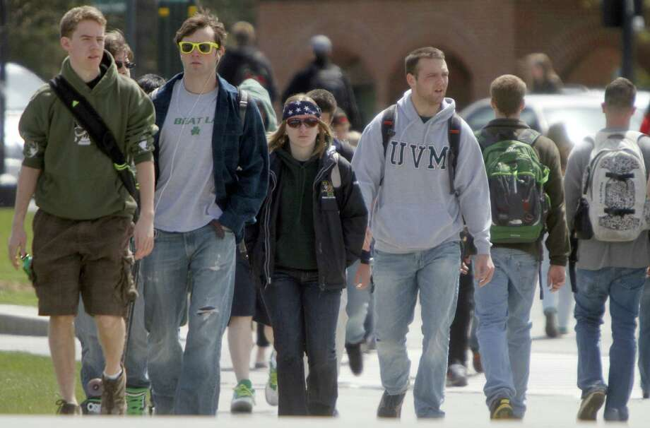 Students walk across campus at the University of Vermont in Burlington. Rating universities should be done carefully and with a broader view than job training. Photo: Toby Talbot / Associated Press / AP
