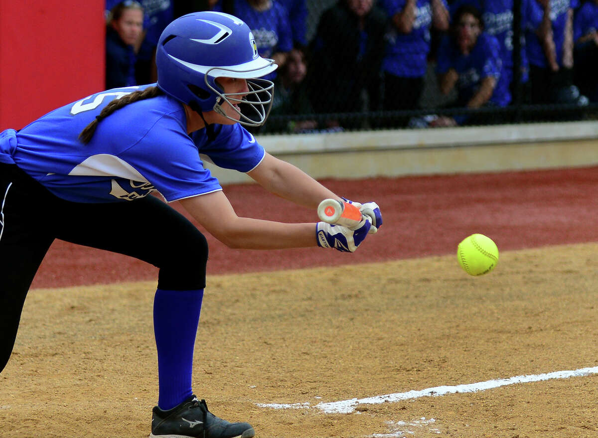 Darien's Avery Maley hits a bunt to advance a runner, during FCIAC Softball Championship semi-final action against Westhill at Sacred Heart University in Fairfield, Conn. on Wednesday May 28, 2014. Westhill lost to Darien 4-1.