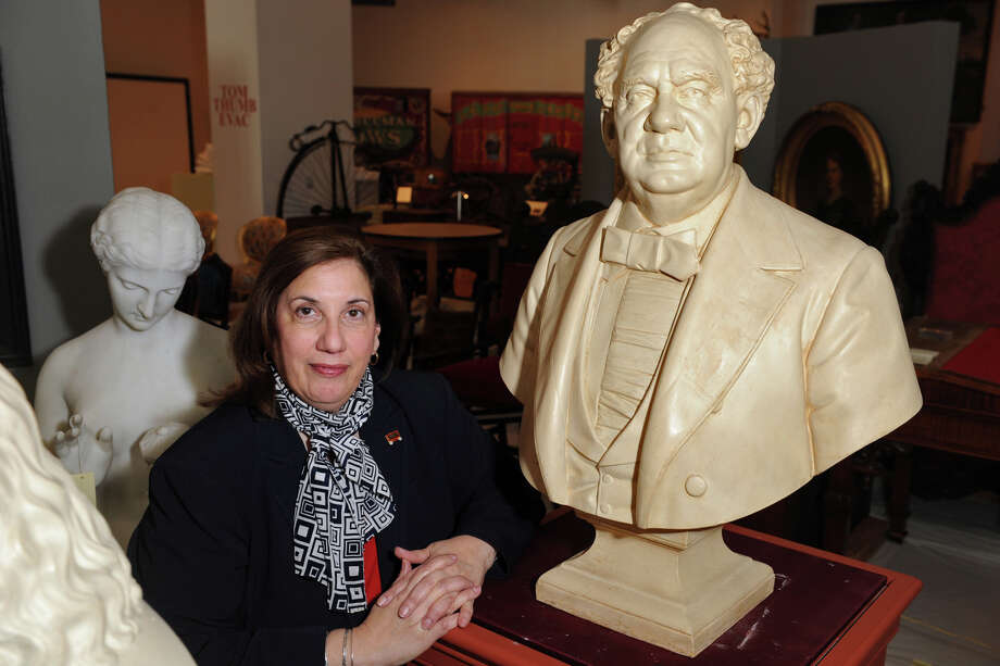 Elaine Ficarra is the new Executive Director of the Barnum Festival. Here she poses with a bust of P.T. Barnum at the Barnum Museum, in Bridgeport, Conn. Nov. 14, 2014. Photo: Ned Gerard / Connecticut Post