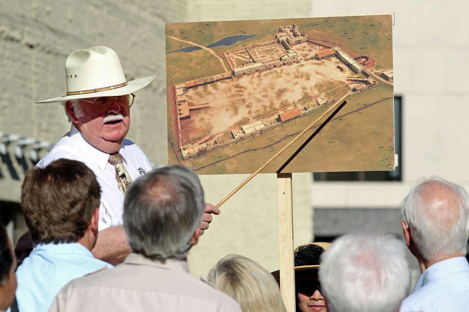 John L. Hinnant points out locations on a drawing of the original Alamo compound boundaries as the city's Alamo Plaza Commission tours the site in May. Photo: Tom Reel, San Antonio Express-News