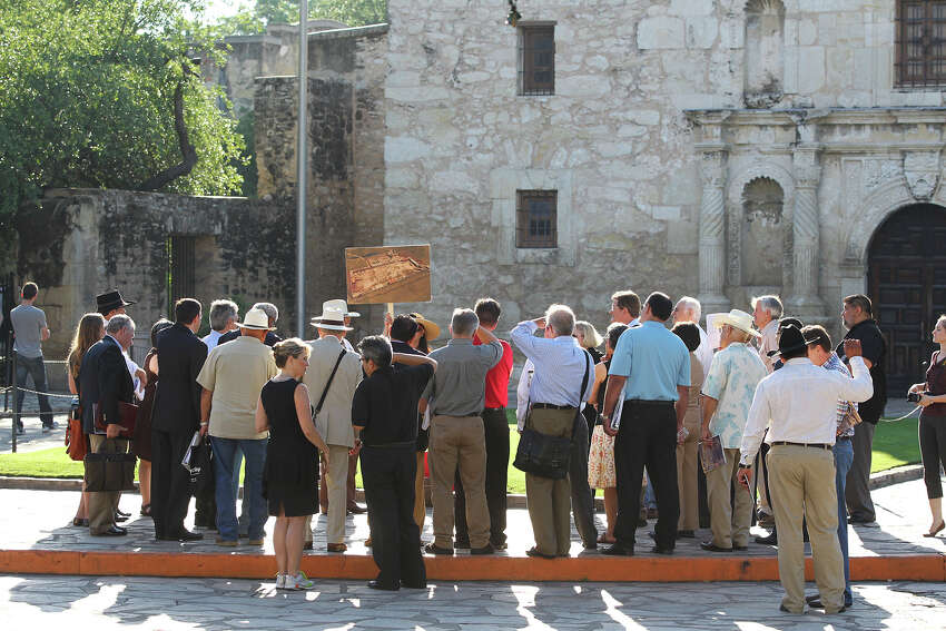 A drawing of the original Alamo compound boundaries is used as the city's Alamo Plaza Commission tours the site on May 28, 2014.