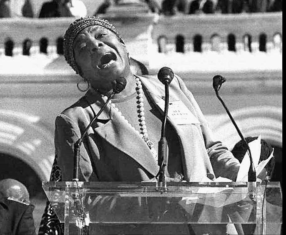 (NYT17) WASHINGTON. -- October 16, 1995 -- MILLION-SCENE, 10-16 -- Maya Angelou wept as she recited a poem before the hundreds of thousands of black men gathered at the Million Man March at the Capitol in Washington. On a day that black men set aside to empower themselves and connect with one another, their relationships with black women were also on the agenda. (Ozier Muhammad/New York Times Photo.) ALSO RAN: 5/22/97 Photo: Ozier Muhammad, NYT