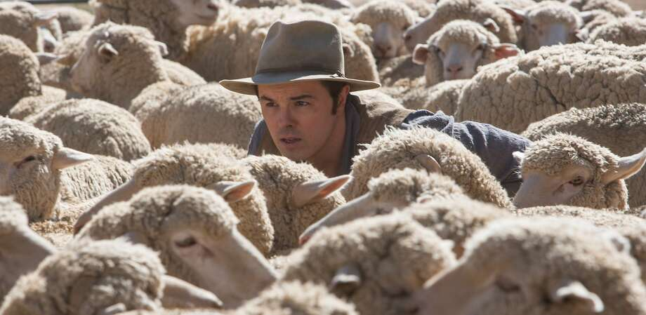 """Seth MacFarlane plays cowardly 19th century sheep farmer Albert in """"A Million Ways to Die,"""" which he also produced, directed and co-wrote. MacFarlane co-stars in the comedy with, below, Amanda Seyfried (left), Neil Patrick Harris and Charlize Theron. Photo: Lorey Sebastian, Universal Pictures"""