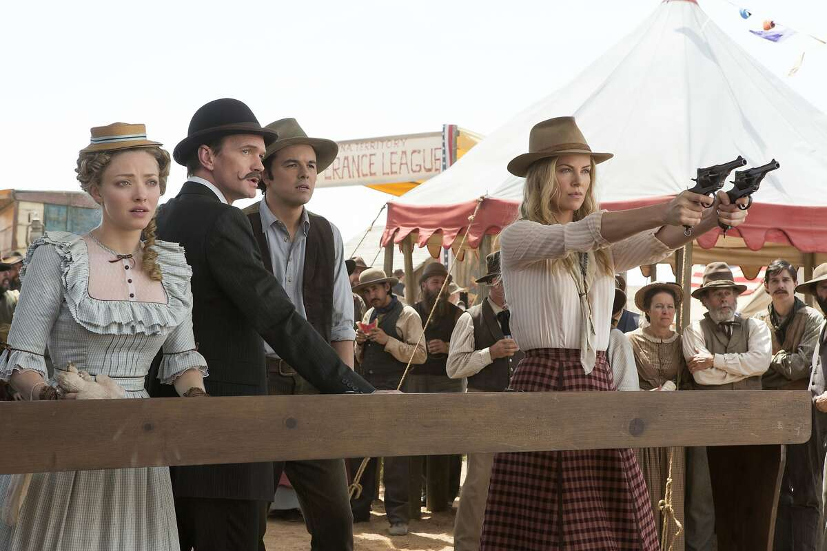Louise (Amanda Seyfried, left), Foy (Neil Patrick Harris), Albert (Seth MacFarlane) and Anna (Charlize Theron) in
