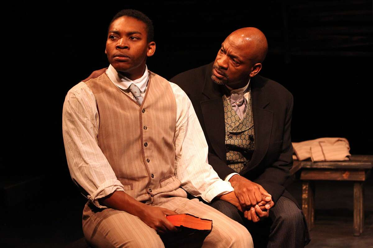 """Jacob (Eddie Ray Jackson, left) and his father Charles (Adrian Roberts) observe the sabbath in Christina Anderson's """"Pen/Man/Ship"""" at Magic Theatre"""