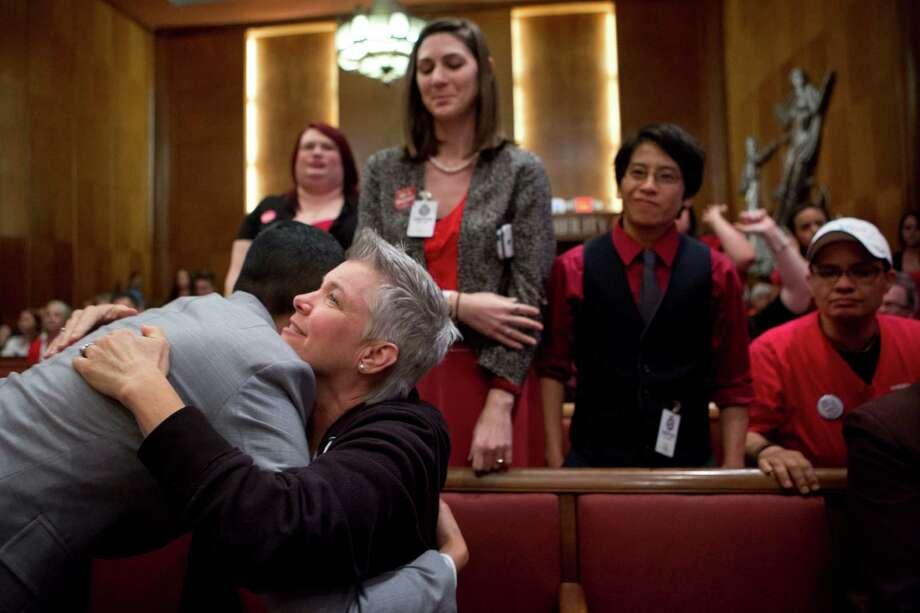 Debbie Kelly, center, embraces Melanie Pang. Photo: Marie D. De Jesus, Houston Chronicle / © 2014 Houston Chronicle
