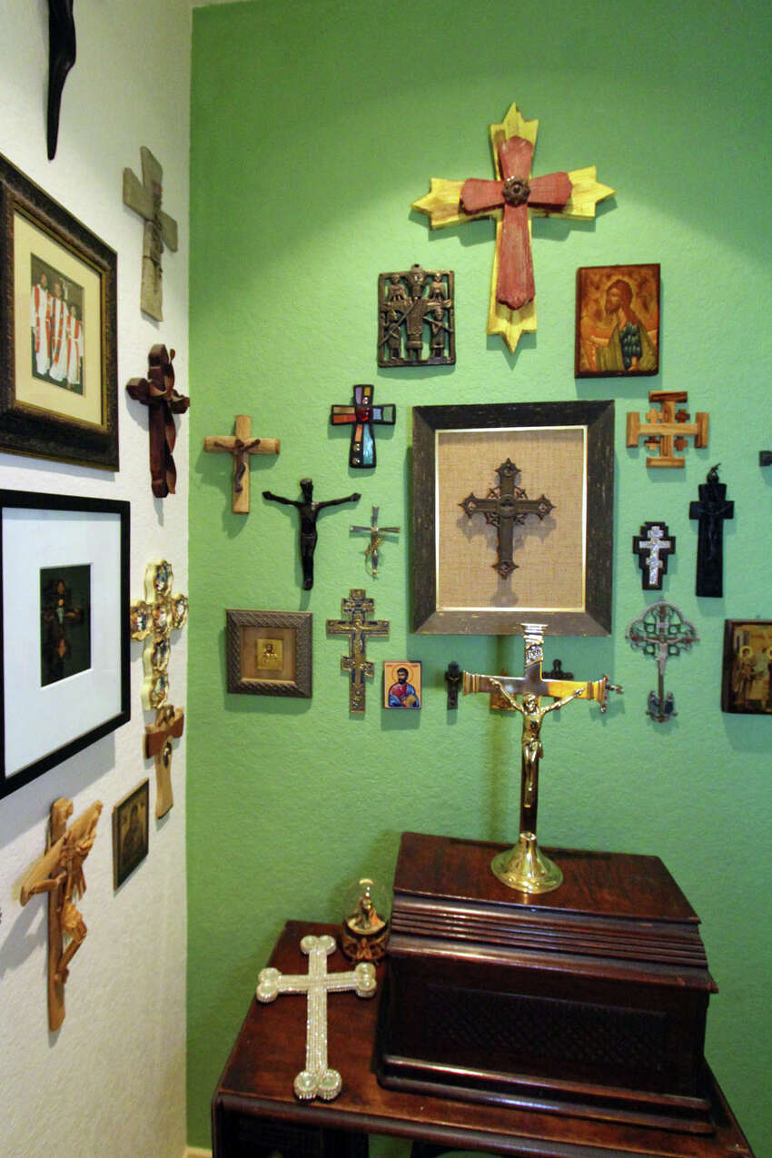 Crosses that Gini Bouzard has collected from all over the world hang on the hallway walls. Under them is the treadle sewing machine that went with her great-grandmother from Tennessee to Louisiana on a wagon. It still works.