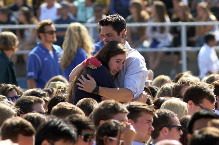 ISLA VISTA, CA - MAY 27:  People hug at a public memorial on the Day of Mourning and Reflection for the victims of a killing spree at University of California, Santa Barbara on May 27, 2014 in Isla Vista, California. Elliot Rodger killed six college students at the start of Memorial Day weekend and wounded seven other people, stabbing three then shooting and running people down in his BMW near UCSB before shooting himself in the head as he drove. Police officers found three legally-purchased guns registered to him inside the vehicle. Prior to the murders, Rodger posted YouTube videos declaring his intention to annihilate the girls who rejected him sexually and others in retaliation for his remaining a virgin at age 22.  (Photo by David McNew/Getty Images) ***BESTPIX*** Photo: David McNew, Stringer / 2014 Getty Images