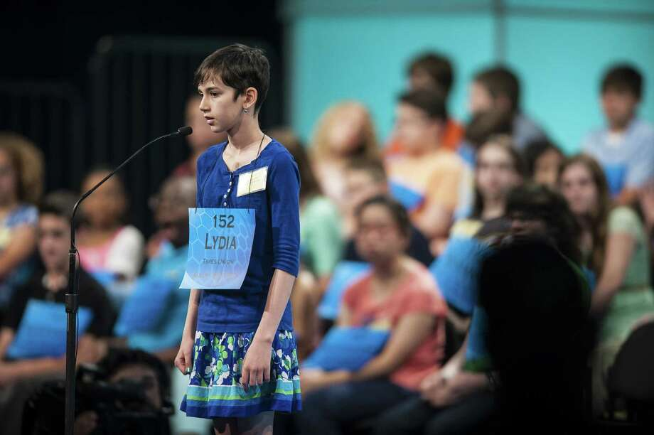 Lydia Loverin, 12, of Mountain Road School in New Lebanon, Columbia County, participates in round three of the preliminaries of the Scripps National Spelling Bee on May 28, 2014 at the Gaylord National Resort and Convention Center in National Harbor, Md. (Pete Marovich/Special to the Tiimes Union) Photo: Pete Marovich / Pete Marovich Images