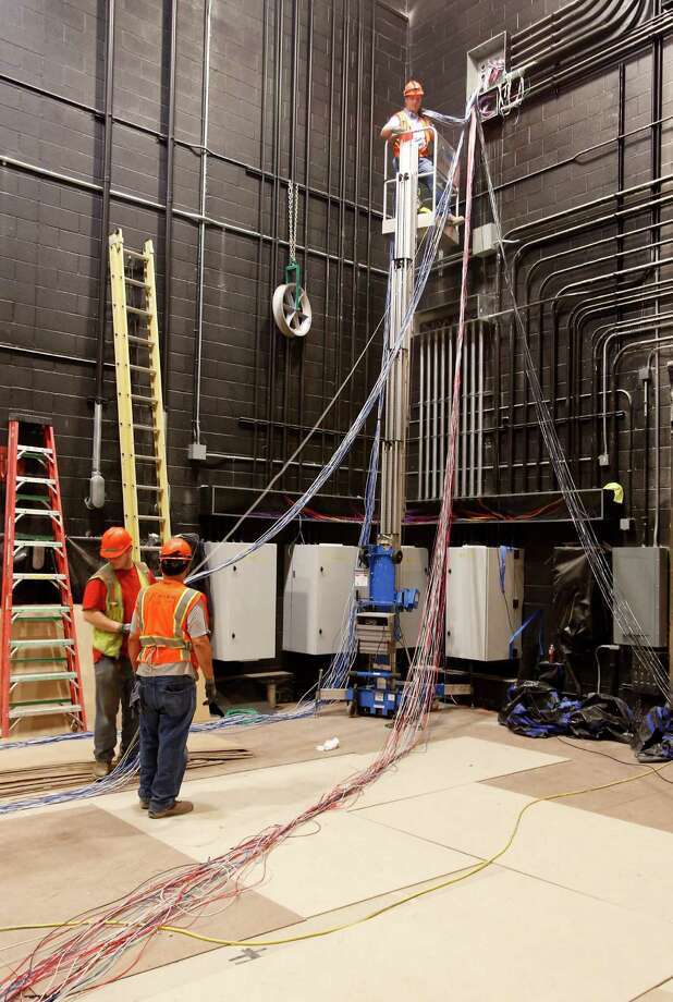 Workers run bundles of cables through the rage area of the still-under-construction Tobin Center for the Performing Arts Thursday May 22, 2014 in San Anotnio. Photo: William Luther, San Antonio Express-News / © 2014 San Antonio Express-News