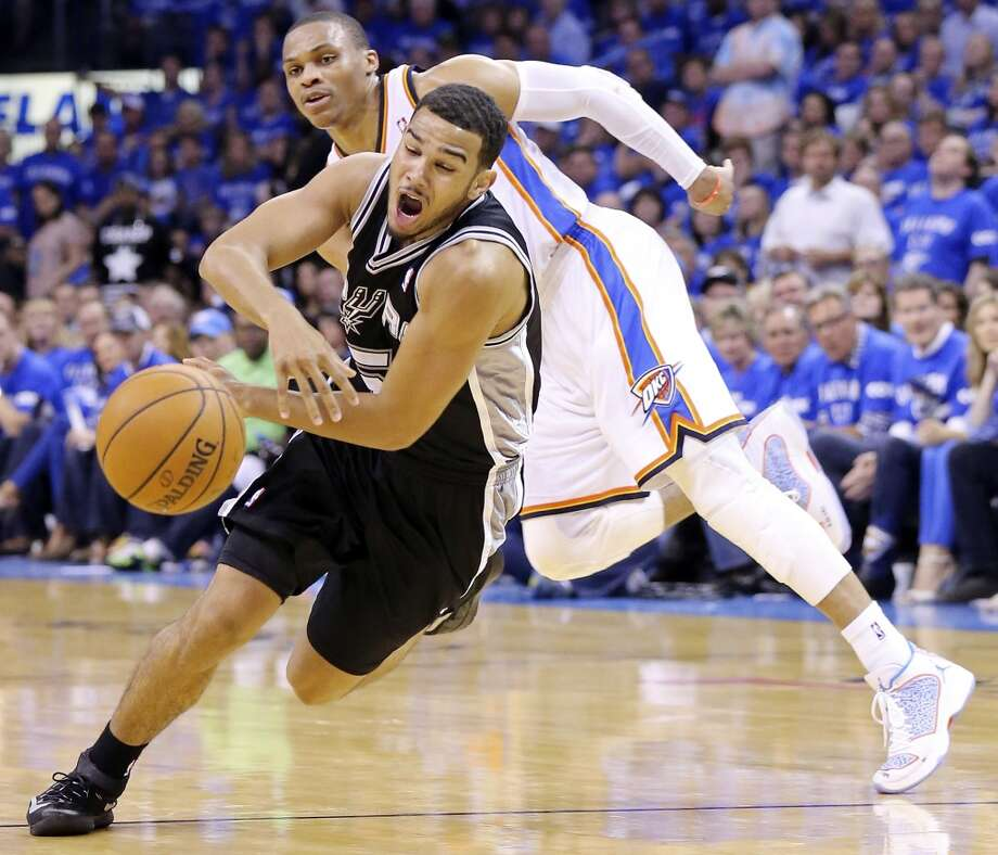 San Antonio Spurs' Cory Joseph loses the ball as he drives around Oklahoma City Thunder's Russell Westbrook during second half action in Game 3 of the Western Conference Finals Sunday May 25, 2014 at Chesapeake Energy Arena in Oklahoma City, OK. The Thunder won 106-97. Photo: Edward A. Ornelas, San Antonio Express-News