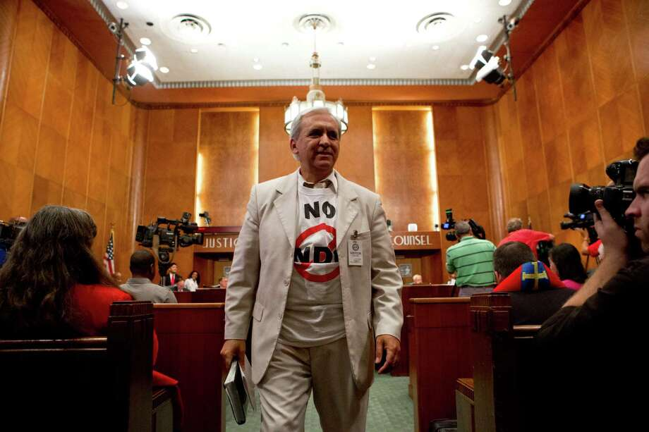 David Maldonado walks away after placing his case against the equal rights ordinance to the Houston City Council, Wednesday, May 28, 2014, in Houston. Photo: Marie D. De Jesus, Houston Chronicle / © 2014 Houston Chronicle